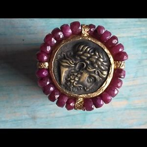 Bronze coin and pink sapphire ring